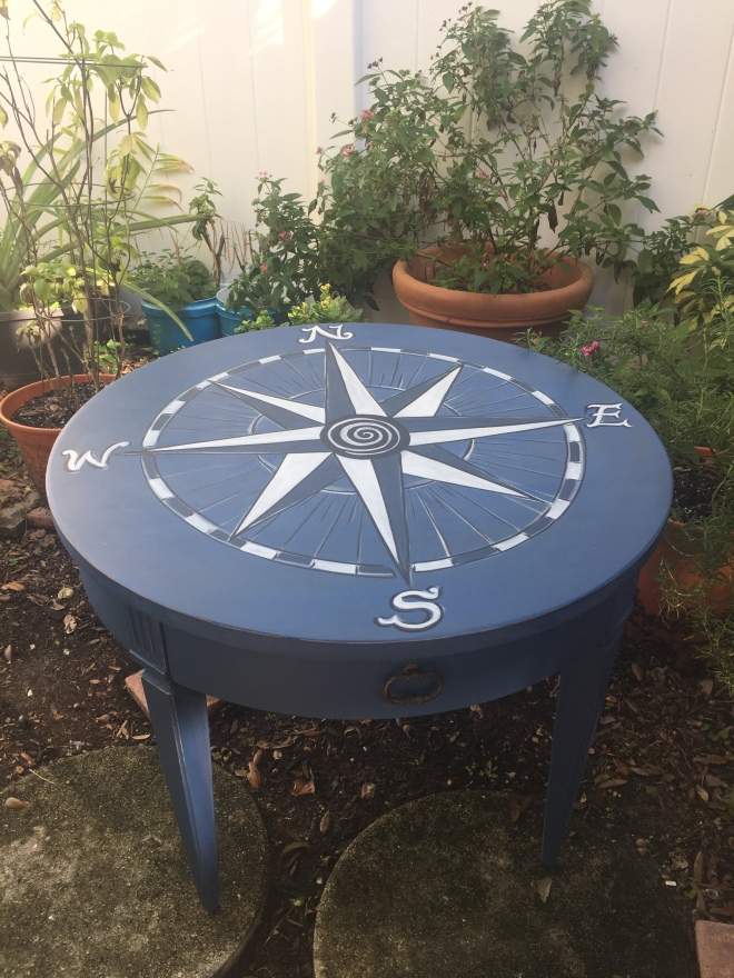 Round table painted with compass rose