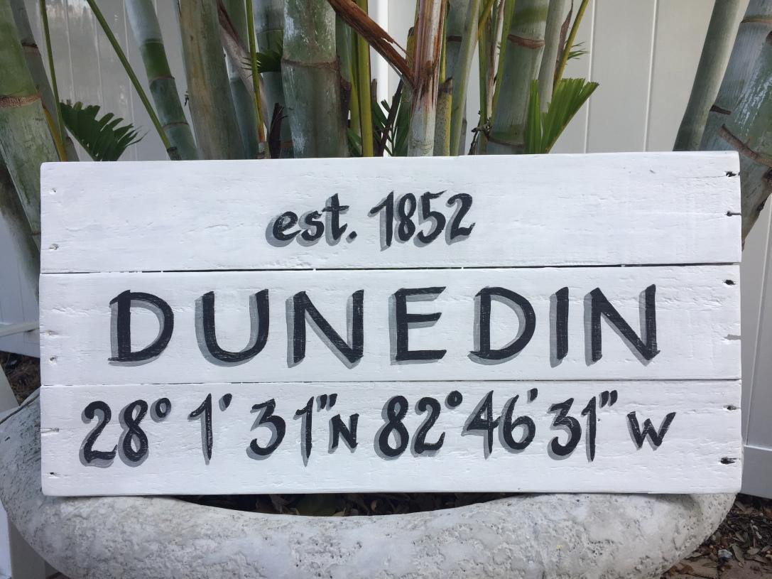 Wooden sign, Dunedin est. and coordinates