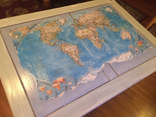 Table with decoupaged world map