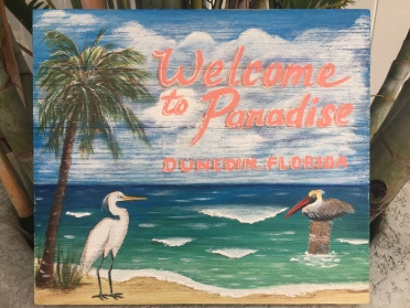 Wooden sign -- Welcome to Paradise